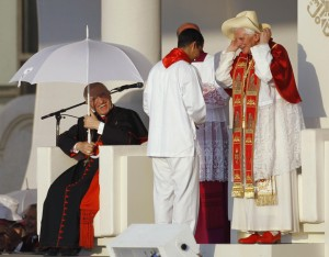 Archbishop of Madrid Rouco Varela laughs as Pope Benedict XVI puts on a hat during a welcoming celebration in central Madrid